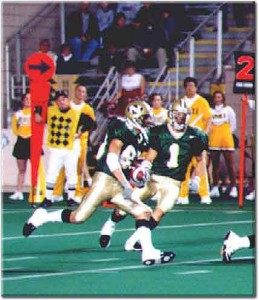 Manny busting a screen pass for a touchdown at the University of Northern Michigan